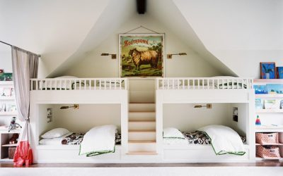 Bunk beds and shelving for books in a children's bedroom (Source: Lonny)