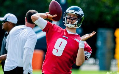 Eagles QB Nick Foles in red practice jersey preseason throwing