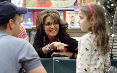 """Sarah Palin gestures during a book signing, Tuesday, Nov. 12, 2013 in Bethlehem, Pa. The former Alaska governor and 2008 Republican vice presidential nominee signed copies of her new book, """"Good Tidings and Great Joy: Protecting the Heart of Christmas"""". Palin chose to start her book tour near a city with obvious connections to the holiday. Bethlehem was founded by Moravians on Christmas Eve, 1741. Its nickname is the """"Christmas City"""" and the city draws many tourists during the holiday season. (AP Photo/The Express-Times, Matt Smith)"""