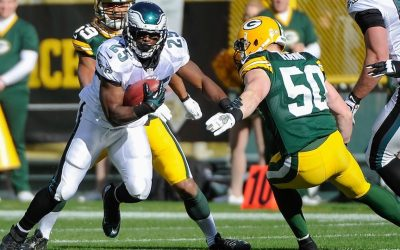 Nov 10, 2013; Green Bay, WI, USA; Philadelphia Eagles running back LeSean McCoy (25) runs with the ball past Green Bay Packers linebacker A.J. Hawk (50) in the first quarter at Lambeau Field. Mandatory Credit: Benny Sieu-USA TODAY Sports
