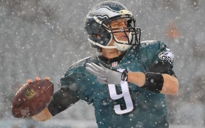 Nick Foles tries to get warm prior to the game against the Detroit Lions at the Lincoln Financial Field Snow Bowl