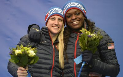 Jamie Greubel and Aja Evans (USA) celebrate winning bronze in women's bobsleigh during the Sochi 2014 Olympic Winter Games at Sanki Sliding Center. Photo   Jack Gruber-USA TODAY Sports