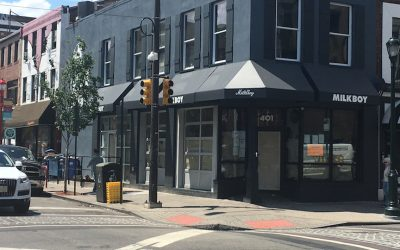 This photo shows the new MilkBoy South location at 4th and South streets in Philadelphia. It's the site of a controversy because of a dumpster parked in front of it. The dumpster is also seen in the photo.