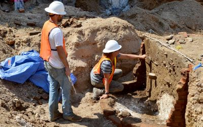 Archaeologists excavate a privy in Old City