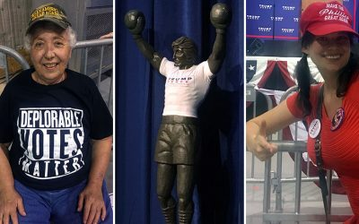 "A woman in a ""Deplorable Voters Matter"" t-shirt, a Rocky statue with a Trump/Pence shirt, and Emily Youcis (Pistachio Girl) decked out in Trump gear"