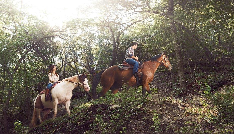 At Travaasa, guests can try their hand at horseback riding. Photo via istockphoto