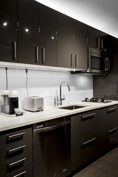 Sexiness and the single kitchen: The galley kitchen is designed to meet the needs of a tenant living solo with its two-burner gas cooktop and extra counter space.