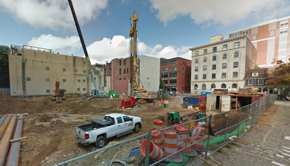 more than 100 bodies found at old city construction site