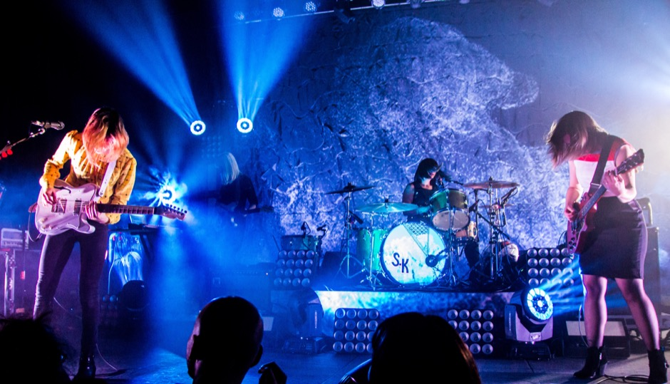 """Sleater-Kinney (Union Transfer, 2015) Says Sikich: """"To witness these performers in their full band element is to experience rock perfection. And this image, showing the kinetics of Carrie, Corin and Janet juxtaposed with the stunning lights is what music photography is all about, capturing what you hear in an image."""""""