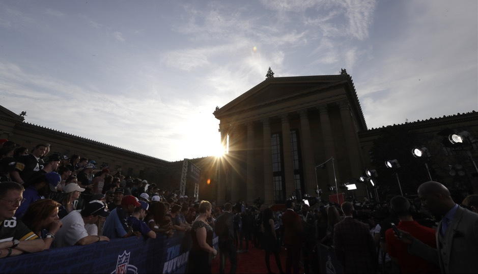 Fans and media gather on the red carpet before the first round of the 2017 NFL football draft, Thursday, April 27, 2017, in Philadelphia. (AP Photo/Julio Cortez)