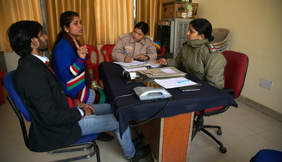 A woman and her husband talk to the marriage cops.