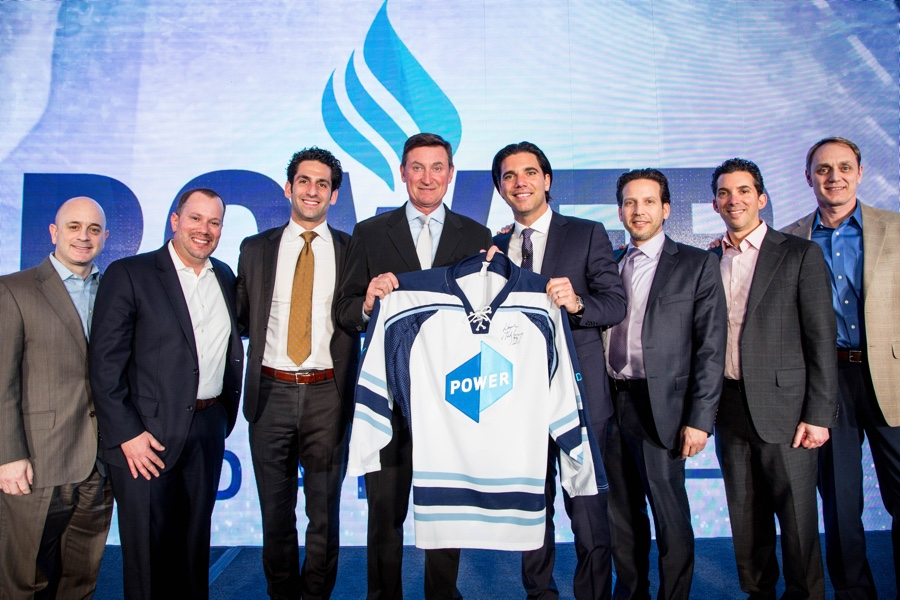 c9af14b12f70 Raphael with Wayne Gretzky and Power s executive team at a Leadership  Conference. Courtesy photo.