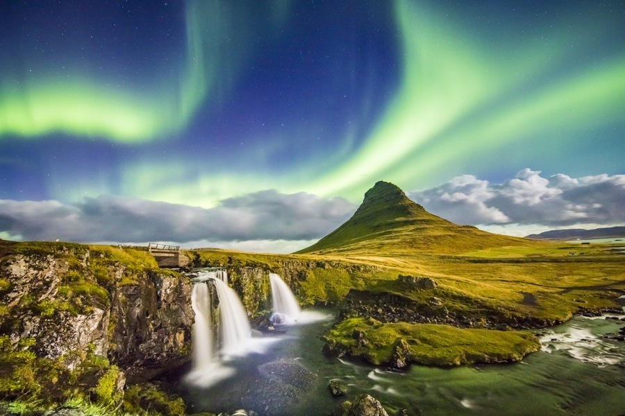 Scenic View Of Aurora Over Kirkjufell And Waterfall Idyllic Northern Lights In Iceland Simonskafar Istock