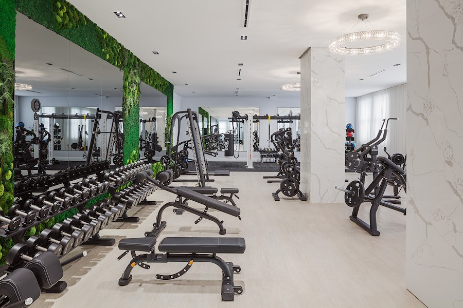the atlantic apartments fitness center green wall