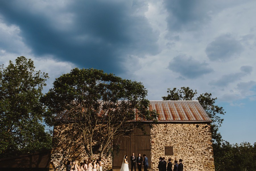 outdoor wedding ceremony at a barn