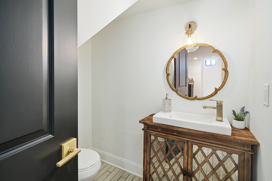 house for sale pennsport rehabbed expanded rowhouse basement powder room