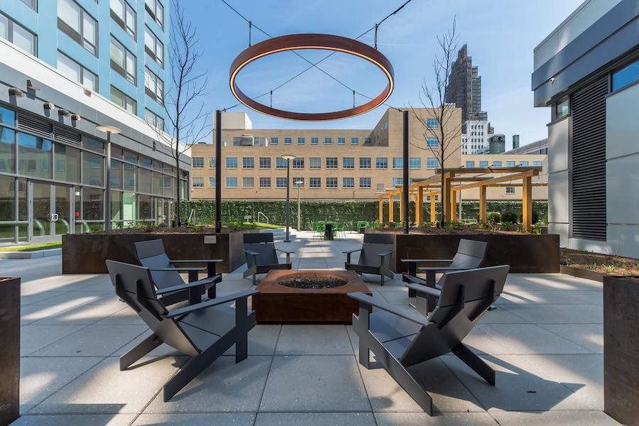 the hamilton apartment profile courtyard fire pit