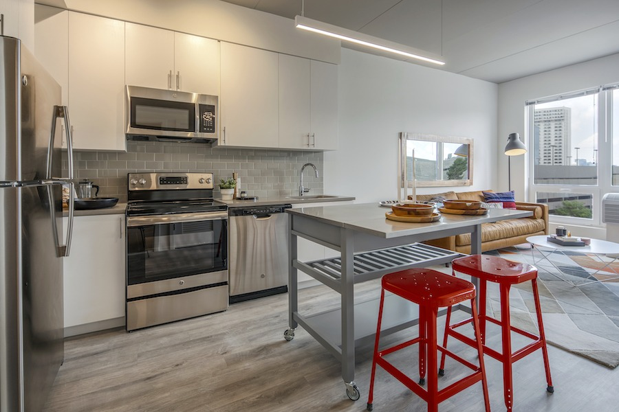 the hamilton apartment profile model one-bedroom kitchen and living room