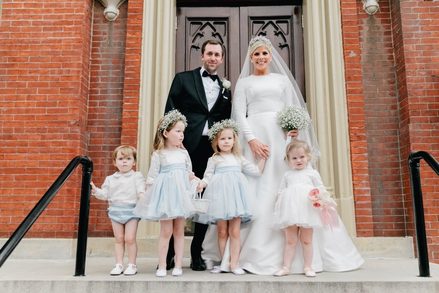 Groom, bride and flower girls