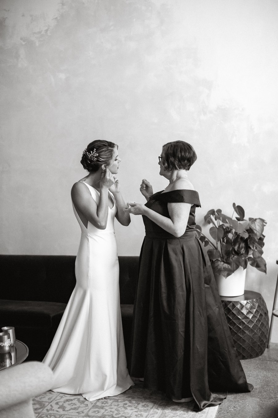 Bride and mother getting ready