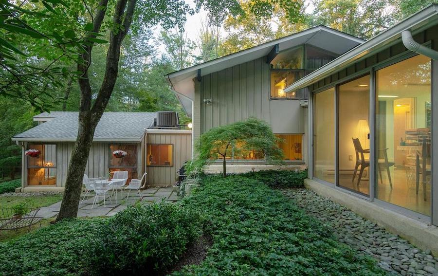 house for sale barren hill midcentury modern rear patio and living room wing