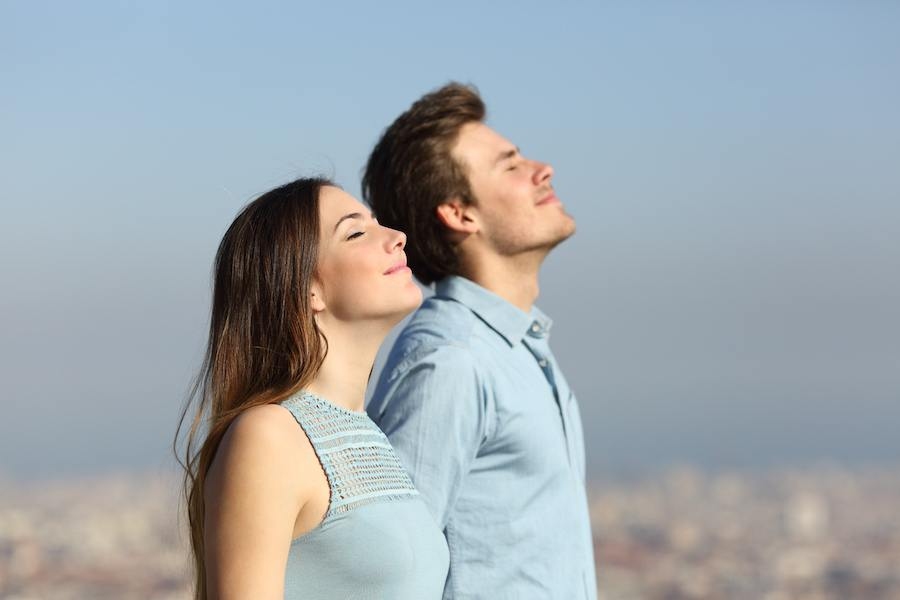 relaxed couple breathing