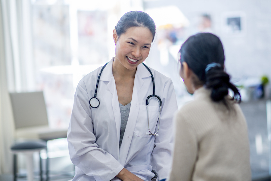 fertility doctor speaking to female patient
