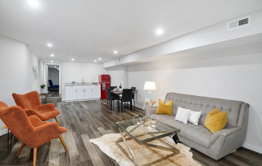 cobbs creek renovated corner rowhouse basement lounge