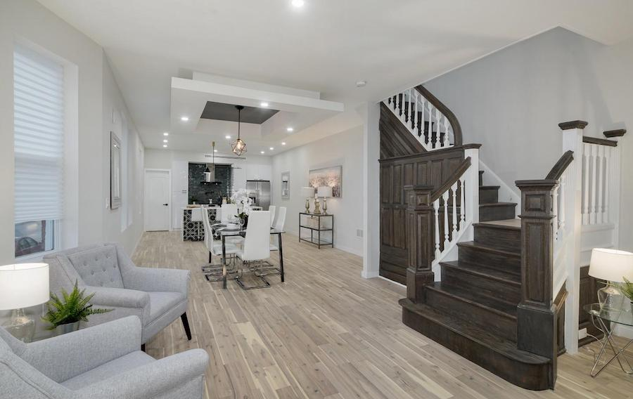 house for sale cobbs creek renovated corner rowhouse dining room and main staircase
