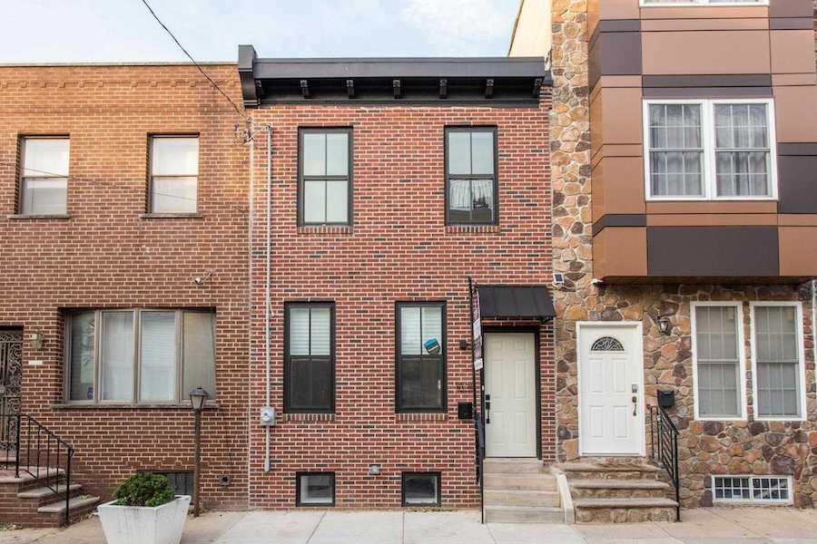 house for sale point breeze modern workingman's row house exterior front