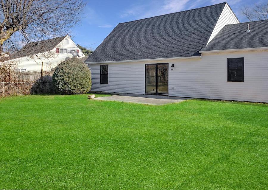 house for sale levittown rebuilt rancher exterior rear