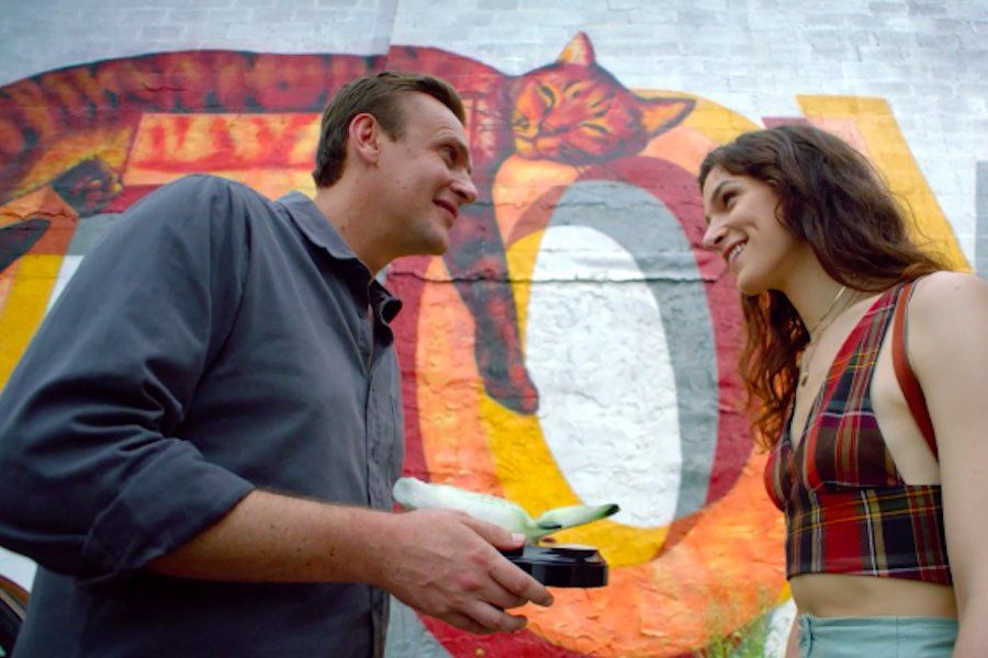 jason segel and dispatches from elsewhere co-star eve lindley in front of the Fishtown cat mural