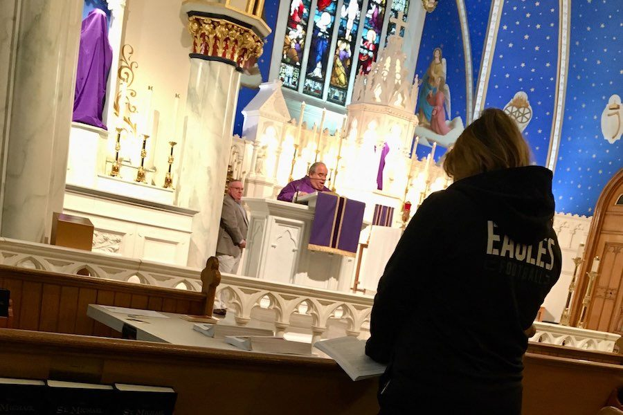 reverend michael rock delivers sunday mass at our lady of lourdes catholic church in philadelphia during the coronavirus crisis