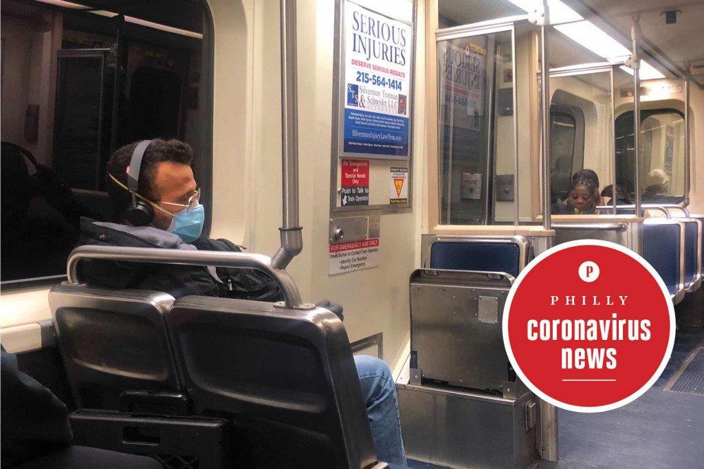 man wearing a face mask on a septa train during the philadelphia coronavirus scare