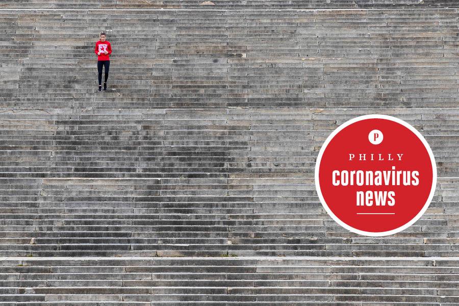 a woman runs on the philadelphia art museum steps during the coronavirus crisis in philadelphia