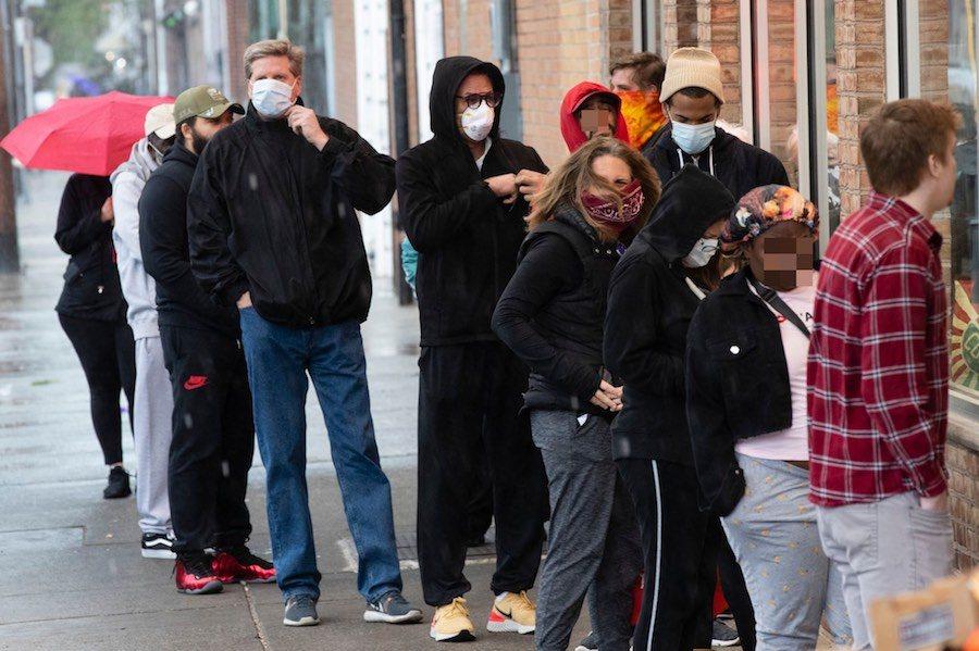 shoppers not social distancing in the italian market in philadelphia during the coronavirus outbreak