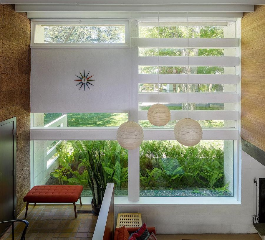 midcentury modern roxborough house for sale foyer and living room
