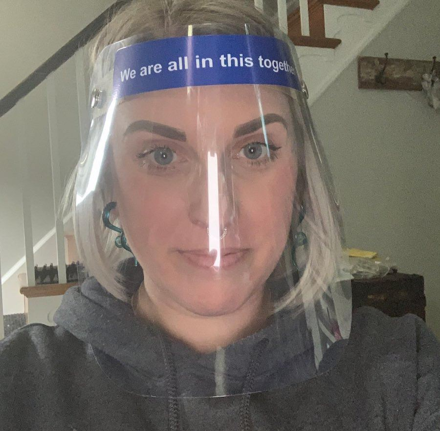 nichole missino in the face shield she bought to wear inside Giovanni's barbershop in Media