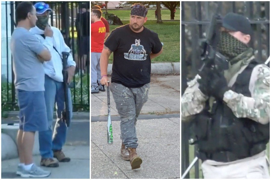 """men armed with guns and bats """"defending"""" the christopher columbus statue in south philadelphia"""
