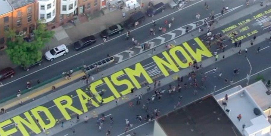 end racism now street art in fishtown