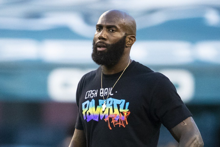 Malcolm Jenkins warms up while wearing a shirt in protest of cash bail before the game a 2018 game against the Atlanta Falcons at Lincoln Financial Field. Now a member of the Saints, he's joining CNN as a commentator.