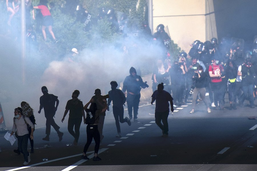 philadelphia police using tear gas on protesters, who are filing a lawsuit over the use of tear gas