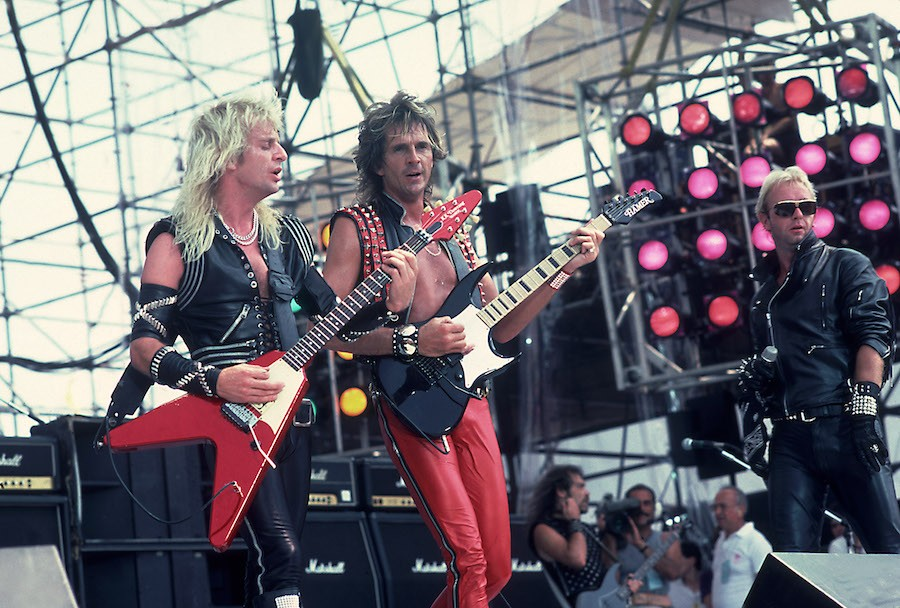 rob halford and other members of judas priest performing at JFK Stadium for Live Aid