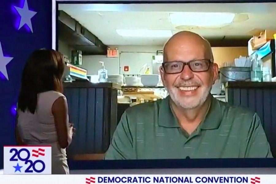eva longoria speaks to swarthmore restaurant owner scott richardson during DNC day one