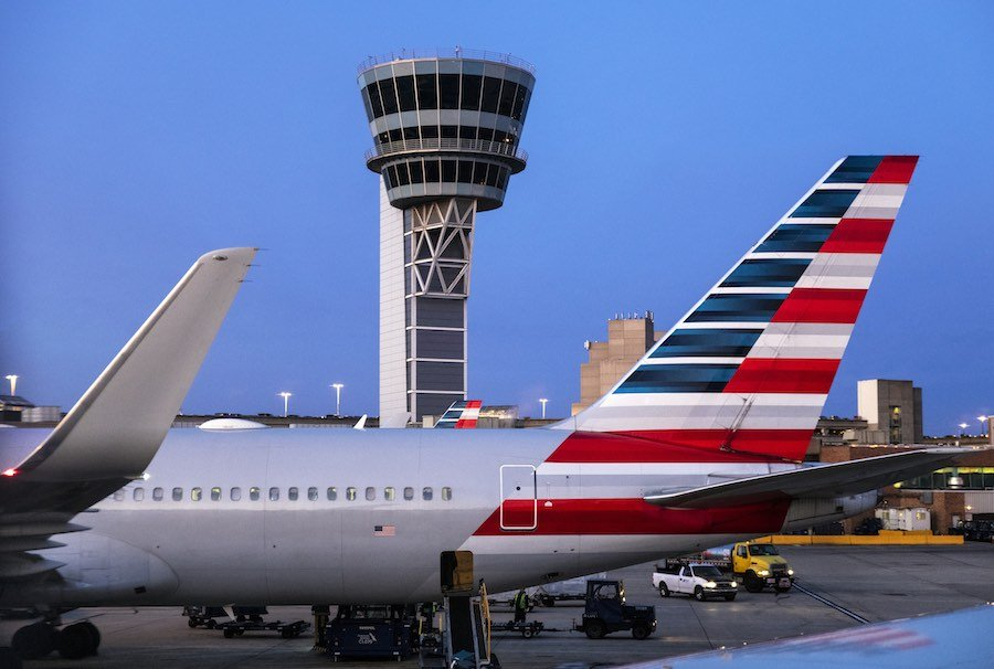 airplanes and the control tower at Philadelphia International Airport, where international flights have just resumed