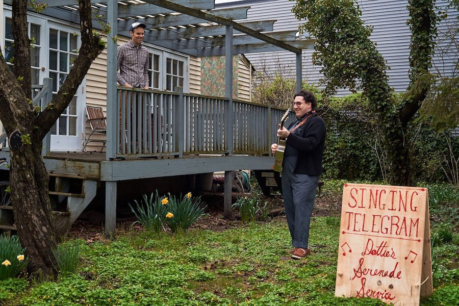dot levine performing a dottie's serenade service gig in a backyard