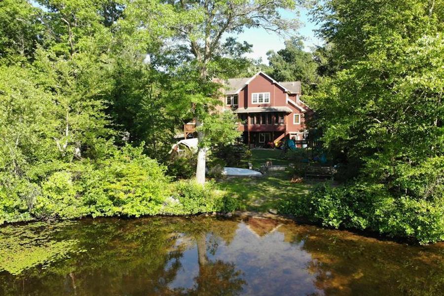 white heron lake house for sale exterior rear