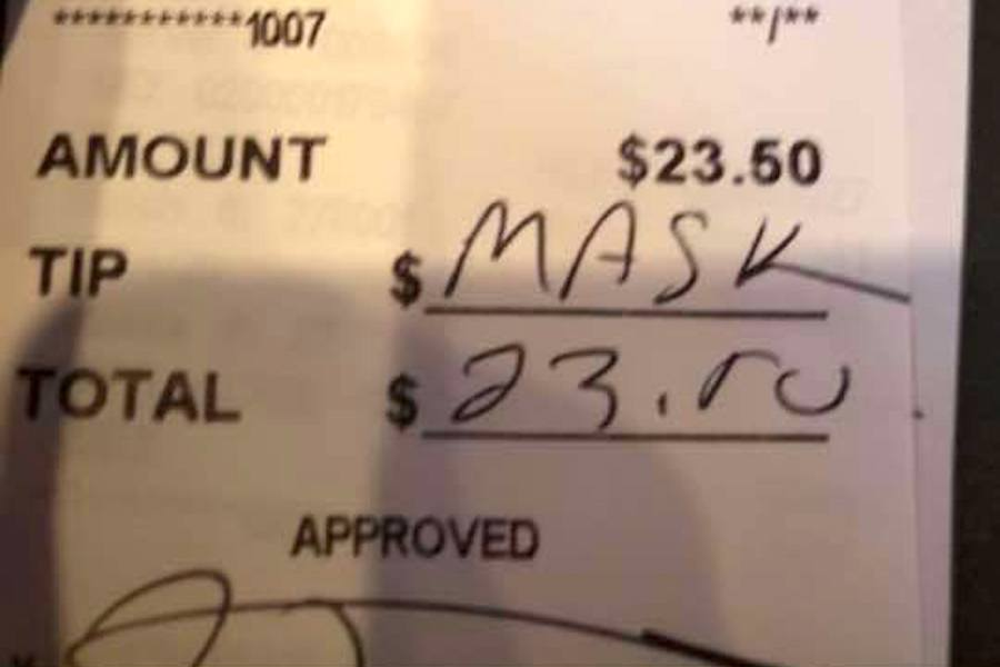 A credit card slip from John Henry's Pub, a restaurant in Ardmore. The customer who signed it was apparently unhappy that his server had asked him to wear a mask while not seated. (Photo via John Henry's Pub)