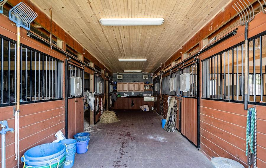 Horse stalls in barn