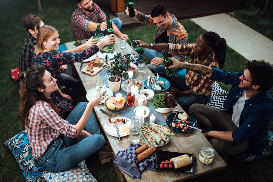 friends enjoying an outdoor thanksgiving, which you can't really do in Philadelphia thanks to new COVID restriction